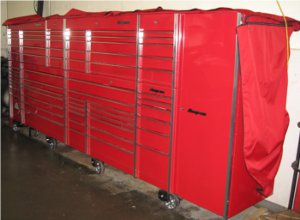 big red toolbox dust cover rolled up